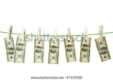 Money laundering concept with dollars on the rope - stock photo