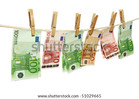 Money laundering on clothesline isolated on white background - stock photo