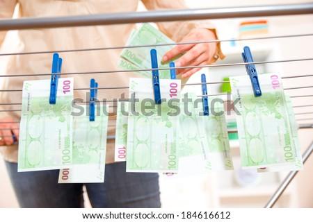 Money laundry, euro banknotes on clothesline - stock photo