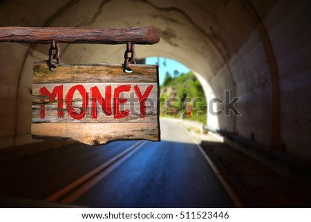 Money motivational phrase sign on old wood with blurred background