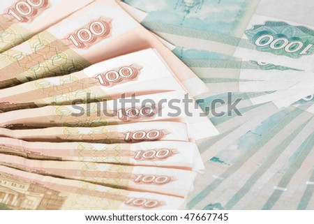 Money of Russia -  closeup of 100 and 1000 roubles banknotes - stock photo