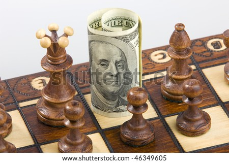 Money on chess board concept business background - stock photo