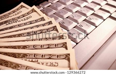 money on computer keyboard - stock photo