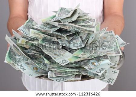 Money on tray - stock photo