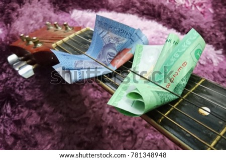 Money Put Between Chords Classical Guitar Stock Photo (Royalty Free ...