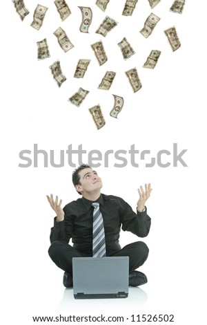 Money raining down on a businessman with a laptop - stock photo