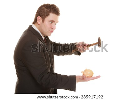 money saving concept. Nerdy funny business man guy with hammer about to smash piggy bank isolated on white - stock photo