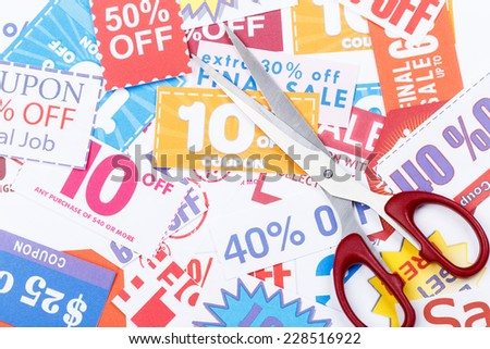 Money saving coupon vouchers with scissors - stock photo