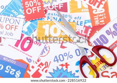 Money saving coupon vouchers with scissors - stock photo