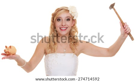 Money saving, marriage and high wedding cost concept. Funny woman bride with hammer about to smash piggy bank isolated on white - stock photo