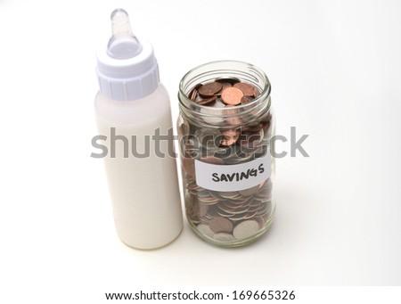 money savings with breast milk or formula - stock photo