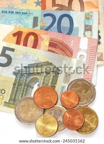 Money Some euro banknotes and coins are spread.  - stock photo