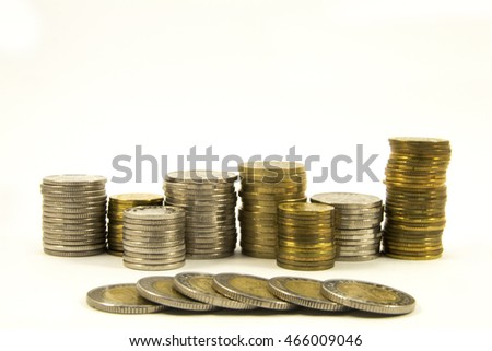 Money, stack of coins on white background.Saving money concept Growing business. Take the risk. Quiet life. Confidence in the future