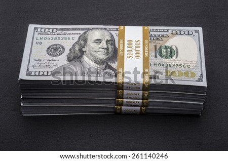 Money Stacks. Stack of money on black background - stock photo