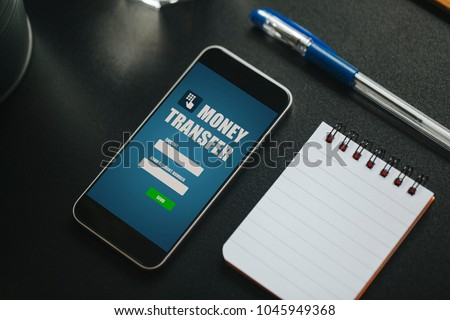 Money transfer app mobile phone screen stock photo 100 legal money transfer app in a mobile phone screen over a black business table reheart Gallery