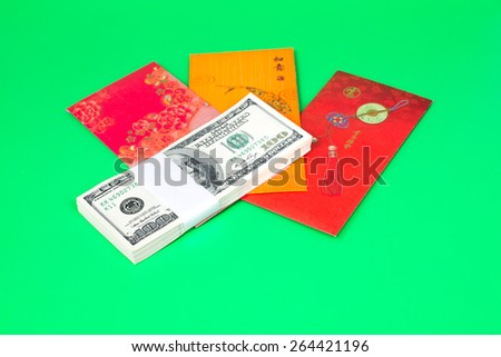 money, US dollar, one hundred dollar notes with red envelopes - stock photo