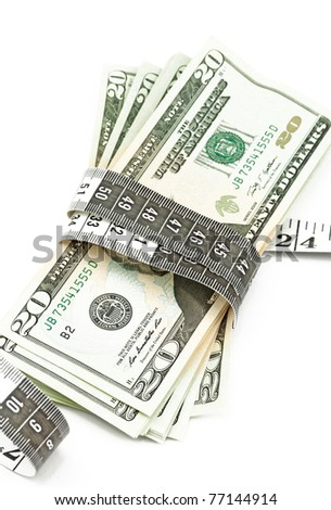 Money with a tape measure - stock photo