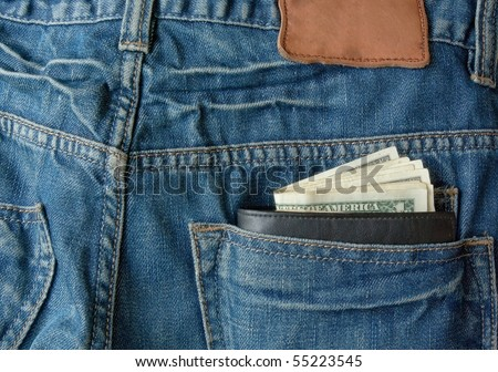 money with purse in back pocket - stock photo