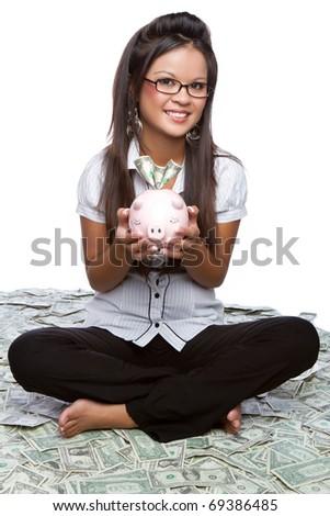 Money woman holding piggy bank - stock photo