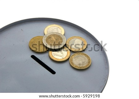 Moneybox and currencies - stock photo