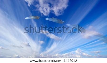 Moneyplane against a blue sky - stock photo