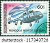 MONGOLIA - CIRCA 1987: A postage stamp printed in Mongolia shows helicopter KA-32, circa 1987 - stock photo