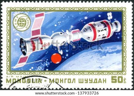 MONGOLIA - CIRCA 1975: A postage stamp printed in Mongolia shows the docking of spacecraft Soyuz - Apollo, circa 1975 - stock photo