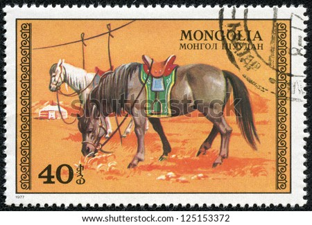 MONGOLIA - CIRCA 1977: A Stamp printed in MONGOLIA, drawn by two horses brown and white that graze on the steppe, circa 1977 - stock photo