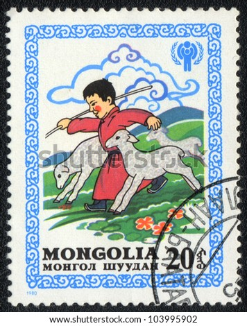 MONGOLIA - CIRCA 1980: A stamp printed in MONGOLIA   shows A boy herding sheep, from series Happy childhood, circa 1980 - stock photo