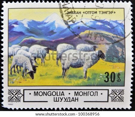 MONGOLIA - CIRCA 1982: A stamp printed in Mongolia shows a flock of sheep, circa 1982 - stock photo