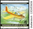 "MONGOLIA - CIRCA 1980: A Stamp printed in MONGOLIA shows the Yanki-anu Plane, from the series ""10th World Aerobatic Championship"", circa 1980 - stock photo"