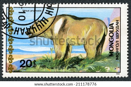"MONGOLIA - CIRCA 1989: A stamp printed in Mongolia shows Tibetan bear, ""Bears"" series, circa 1989  - stock photo"