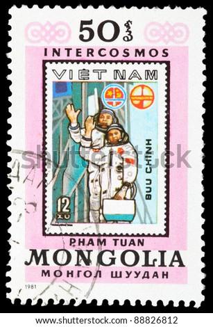MONGOLIA - CIRCA 1981: An airmail stamp printed in Mongolia shows a spaceman, series, circa 1981. - stock photo