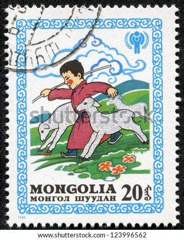 MONGOLIA - CIRCA 1980: stamp printed by Mongolia, shows Boy Running with Lambs, circa 1980 - stock photo