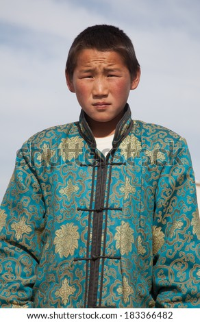 Mongolian boy in traditional costume - stock photo