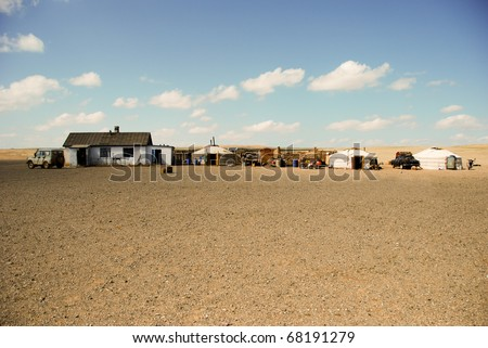 Mongolian Ger on steppes, plateau - stock photo