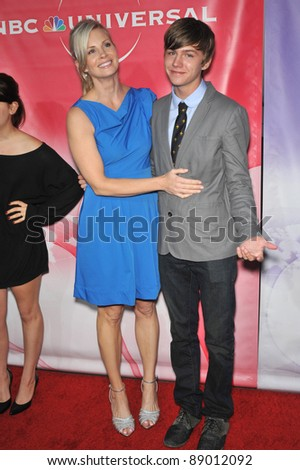 """Monica Potter & Miles Heizer - stars of """"Parenthood"""" - at NBC Universal TV Summer Press Tour Party in Beverly Hills.  July 30, 2010  Los Angeles, CA Picture: Paul Smith / Featureflash - stock photo"""