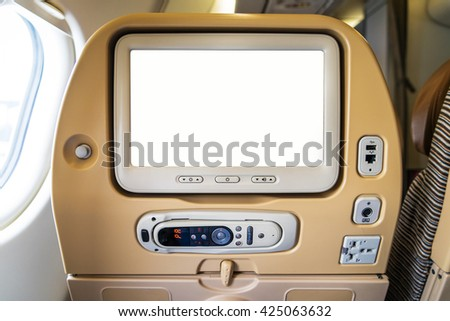 monitor on cabin,Passenger plane interior - stock photo