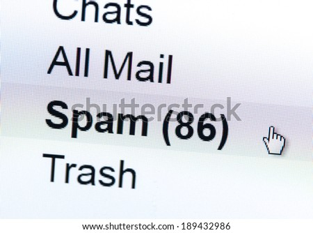 Monitor screen showing spam in the mailbox - stock photo