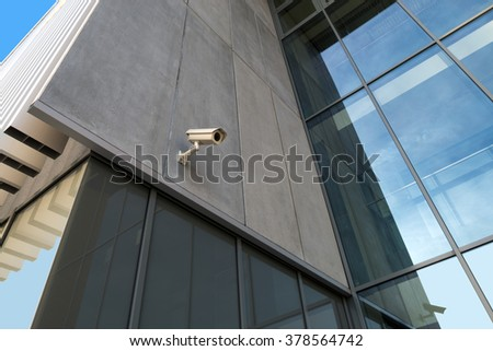 monitoring camera on the new modern building - stock photo