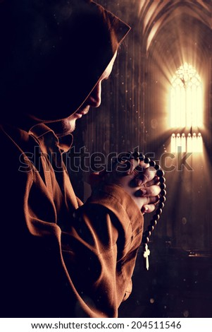 Monk at church - stock photo