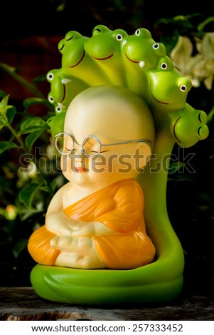 monk doll  meditating to luminosity - stock photo