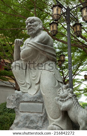 Monk fighter statue with lion. - stock photo