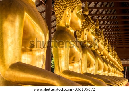 Monk golden image of Buddha