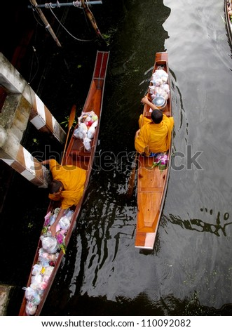 Monk on Woodenboats, Thailand - stock photo