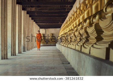 Monk Walk in the temple with Buddha. - stock photo