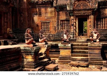 Monkey guardians outside temple at  Banteay Srei, Cambodia - stock photo