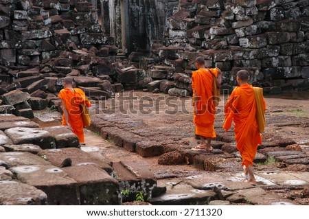 Monks at Angkor Wat - stock photo