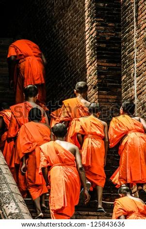 Monks in Ayutthaya, Thailand - stock photo