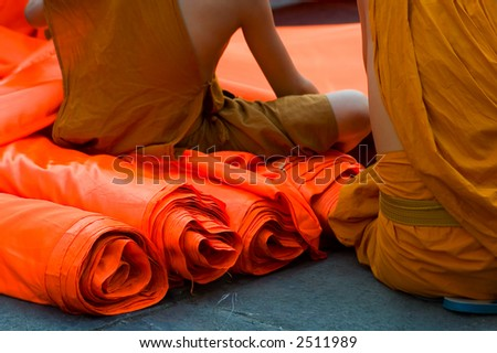 monks sitting on robes - stock photo